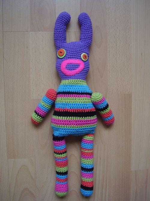 Crochet sock monster lying flat
