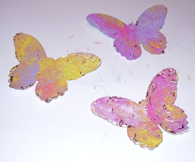 Acrylic paint on cuttlbug butterflies on tinfoil tape