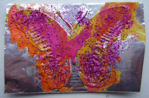 Embossed butterfly on foil tape with gloss coating & glitter