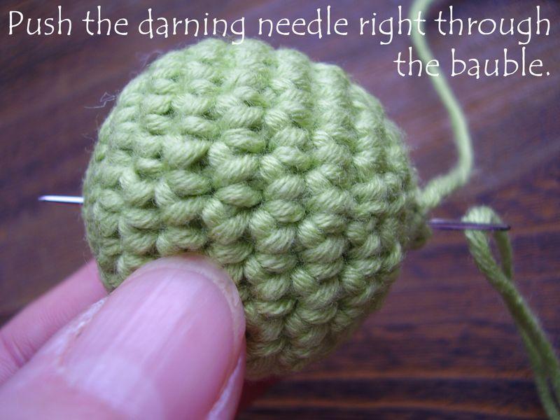 Pic 17   push darning needle through bauble