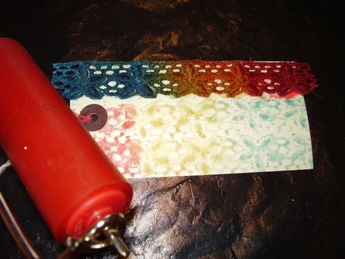 Brayer rolled lace on tag with glimmer mist