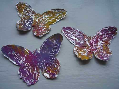 Embossed foil butterflies with acrylic paint
