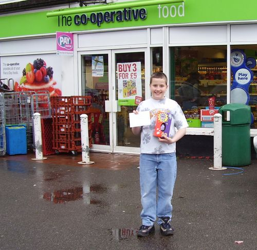Outside shop with prize