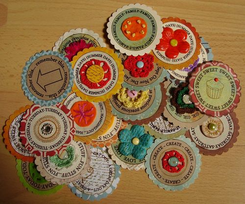 Pile of scalloped scrapbook embellies
