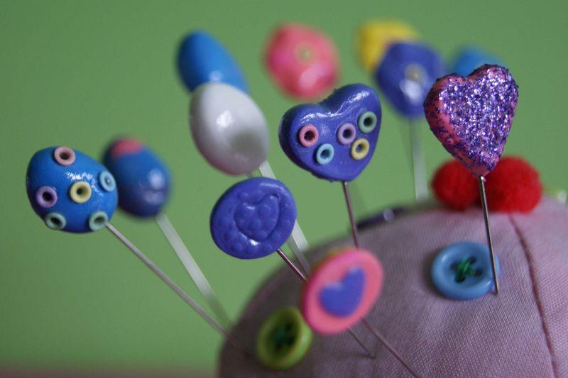 Stick pins close up with mini eyelets and glitter web