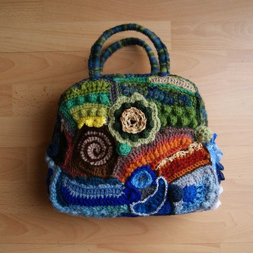 Freeform crochet bag finished back web